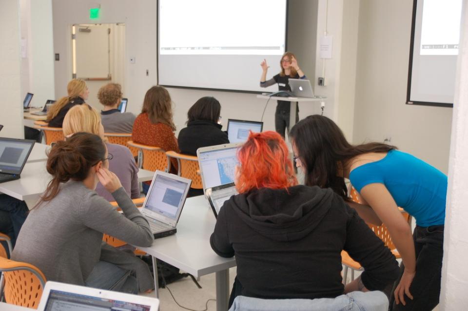 Boston Python Workshop attendees watch a presentation