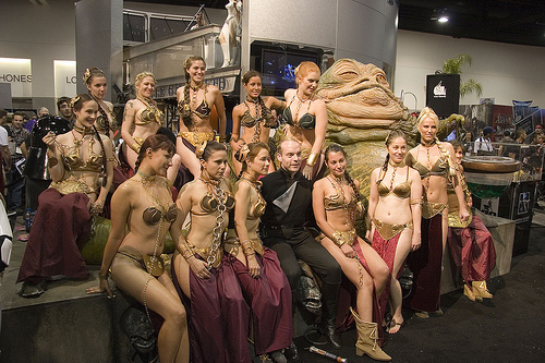 A group of slave Leia cosplayers congregate around Jabba the Hut at Comic-Con.