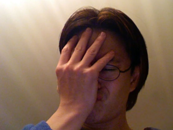 Facepalm: person clutching their face