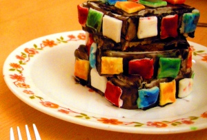 Three layer cake iced to resemble a Rubiks cube (Image by Peter-Ashley Jackson, CC BY-SA.)