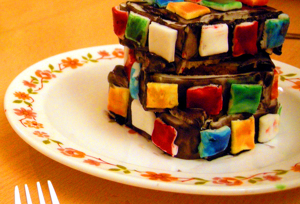 Three layer cake iced to resemble a Rubiks cube