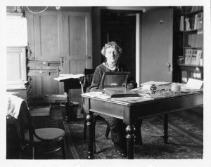 Annie Jump Cannon sitting at her desk