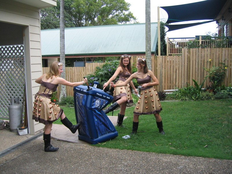 Three women in Dalek costumes attacking an inflatable Tardis
