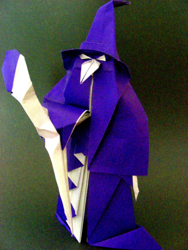 Photograph of an origami wizard in blue and white