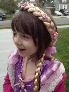 Andrea's daughter Maya, wearing pink and braids