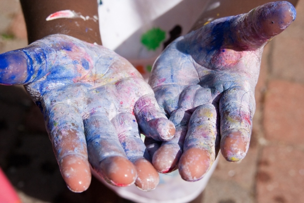 Closeup of the paint-covered hands of a child (by Steven Depolo)