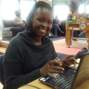 Photograph of Martha Chumo using a laptop