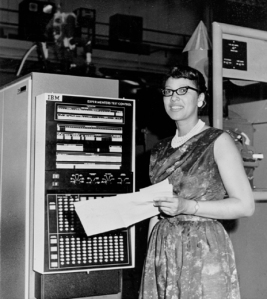 Melba Roy Mouton, standing with computing equipment at Goddard Space Flight Center.