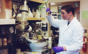 Frances Hocutt looks at a flask in a laboratory