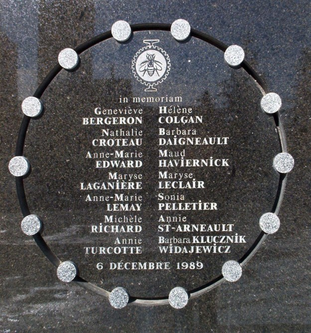 A black plaque engraved with the names of the women who died in the Ecole Polytechnique massacre